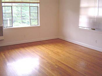 Bedroom with hardwood floors - unrenovated